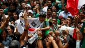 Mexico, South Korea fans celebrate together after knocking out Germany