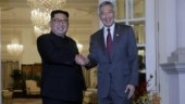 In eye of storm, North Koreans see scant news of Kim's trip