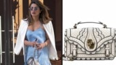 Priyanka carried a cement intrecciato wingtip city knot bag by Bottega Veneta for the date