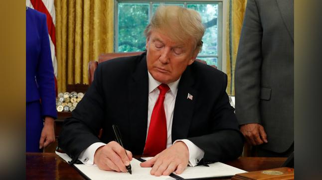 Trump signs executive order terminating immigrant family separation policy