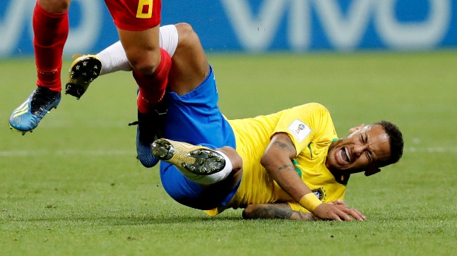 18089503e2b5 Brazil s Neymar reacts after being fouled by Belgium s Thomas Meunier  during the World Cup quarter-