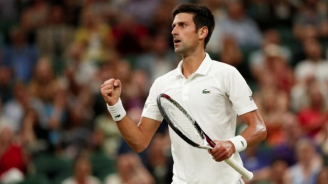 Tennis - Wimbledon - All England Lawn Tennis and Croquet Club, London, Britain - July 13, 2018 Serbia's Novak Djokovic celebrates during his semi final match against Spain's Rafael Nadal