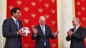 Russian President Vladimir Putin on Sunday handed over the mantle of World Cup host to the emir of Qatar, whose country will stage the 2022 edition of the tournament
