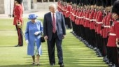 Donald Trump walks with Queen Elizabeth II
