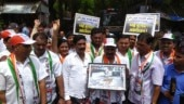 NCP workers protest against BMC, hand photo frame of potholes to ward officer
