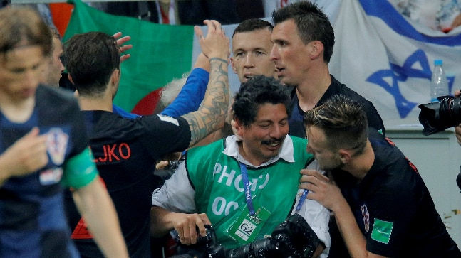 A 2018 FIFA World Cup photographer surprisingly became a part of Croatia's goal celebration vs England in the semi-final. (Reuters Photo)