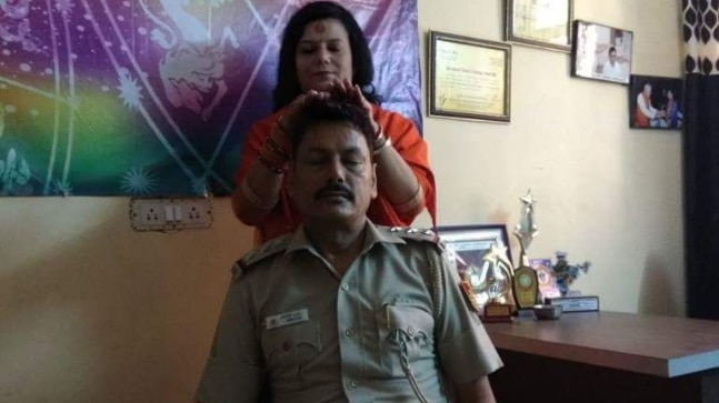 Delhi policeman transferred after photo showing him seeking godwaman's blessing went viral