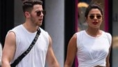 Priyanka Chopra and Nick Jonas twinning in white.