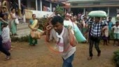 Fact Check: Propaganda over flood relief? Photos of 'BJP' MLA carrying sack of rice on his back go viral