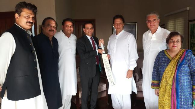 Envoy Ajay Bisaria meets Imran Khan, gifts him cricket bat signed by Indian team