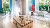 Raseel's master bathroom has a separate shower area, freestanding bathtub, large vanity and ample room