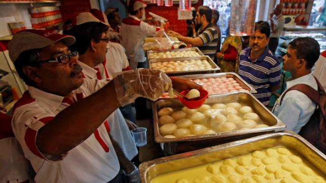 Sweets wrapped in gold vark at this Surat shop costs Rs 9000 per kg