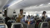 Flight attendants serve snacks on-board Photo: Reuters