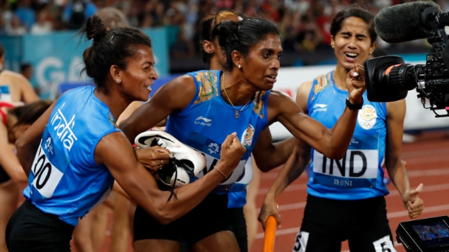 MR Poovamma (centre) won gold along with Hima Das, Saritaben Gaikwad, and VK Vismaya in 4x400m women's relay