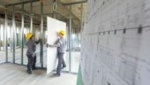 Students are putting gypsum wallboard in a created wall of metal construction in Germany. (Photo courtesy: Getty Images)