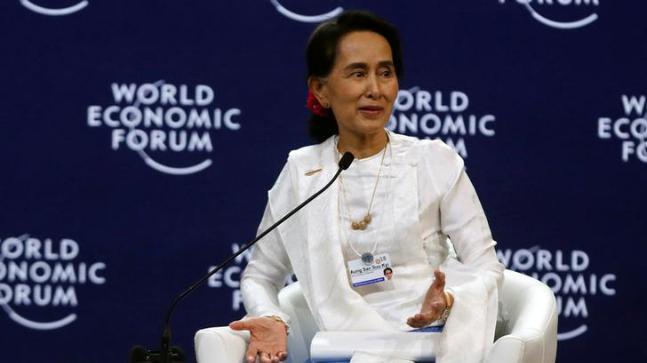Myanmar's Aung San Suu Kyi defends jailing of 2 Reuters journalists