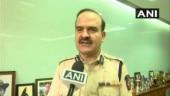 Maharashtra minister defends police press conference on arrest of activists