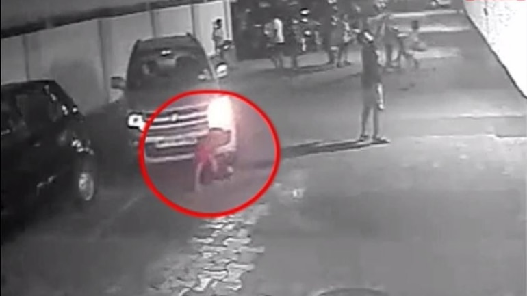 Watch Mumbai Kid Escapes Alive After Being Run Over By A
