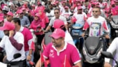 Supporters of Maldivian President Abdulla Yameen ride on their bikes during final campaign march rally ahead of polls