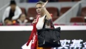 Simona Halep retired from her first round match in the China Open due to a back problem