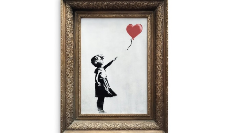 Banksy painting 'self destructs' after being sold for €1.1million