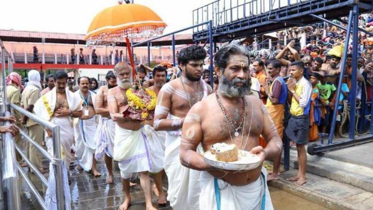 Woman begins climbing Sabarimala hill amid protests
