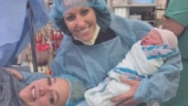 Same-sex couple carries same baby in two wombs!