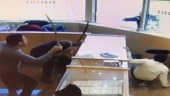 Jewellery store employees fight armed robbers with swords