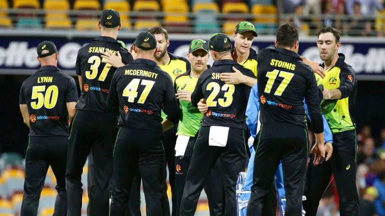 Australia celebrate their victory over India in the first T20 (AP Photo)