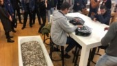 Man goes to buy iPhone with tub full of coins. Photo: Facebook/Ludmila Semushina