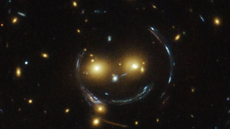 NASA's Hubble Space Telescope Spots Cosmic Smiley Among Colourful Galaxies