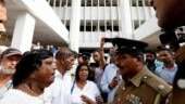 Sri Lanka's police officer advises supporters of the deposed PM Ranil Wickremesinghe-led UNP to leave the court premises, in Colombo, Sri Lanka. (Photo: Reuters)