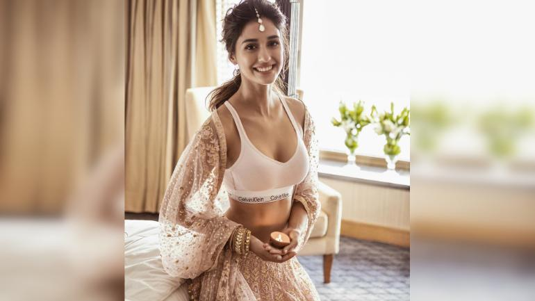60b01c411ee Disha Patani wishes fans on Diwali in sports bra and lehenga