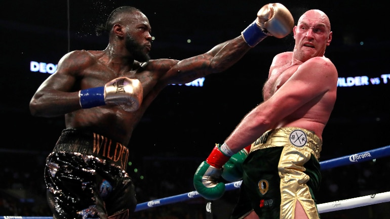 deontay wilder hangs on to wbc heavyweight title after