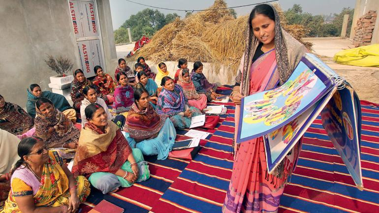 BREAKING BARRIERS: Sabina Khatoon holds a self-help group meeting in Nalanda, Bihar. (Photo: Ranjan Rahi)