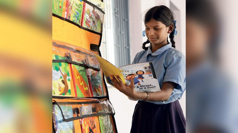 Storyweaver, a digital resource from Pratham books of illustrated storybooks in different Indian language. (Photo: READING ROOM: A free-standing library-in-a-classroom kit in Bengaluru.)