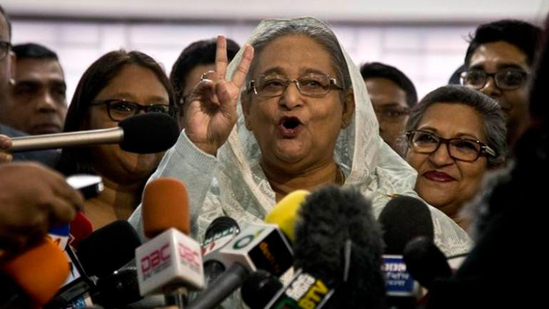 Bangladesh PM Sheikh Hasina speaks to the media persons after casting her vote in Dhaka Bangladesh
