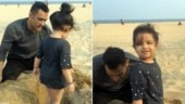 Watch: MS Dhoni and Ziva play in the sand. Sakshi captures adorable moment
