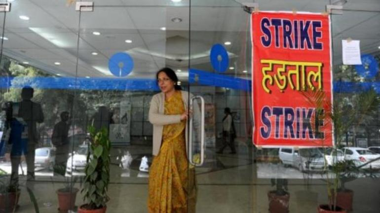 Gujarat: Public sector bank employees join nationwide strike against merger with BoB