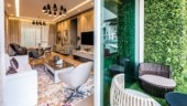 The living room opens into the deck with a vertical garden.