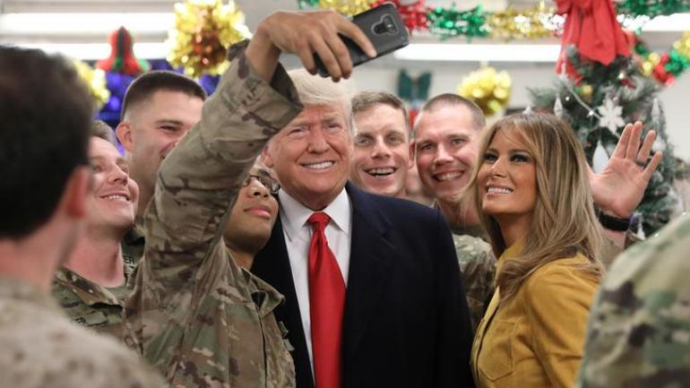 US President Donald Trump makes surprise visit to troops in Iraq