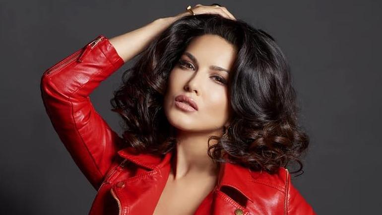 7d28f2244a Sunny Leone goes braless in red hot leather jacket for Dabboo ...