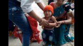 Crying toddler forced to remove black jacket before Assam CM's rally. Watch viral video