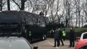 Blackpool fan protests on roof of Arsenal team bus before start of match