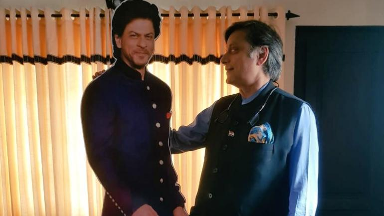 Shashi Tharoor with a cut-out of Shah Rukh Khan