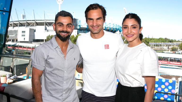 Virat Kohli and Anushka Sharma posed with tennis great Roger Federer at the Melbourne Park on Saturday (AP Photo)