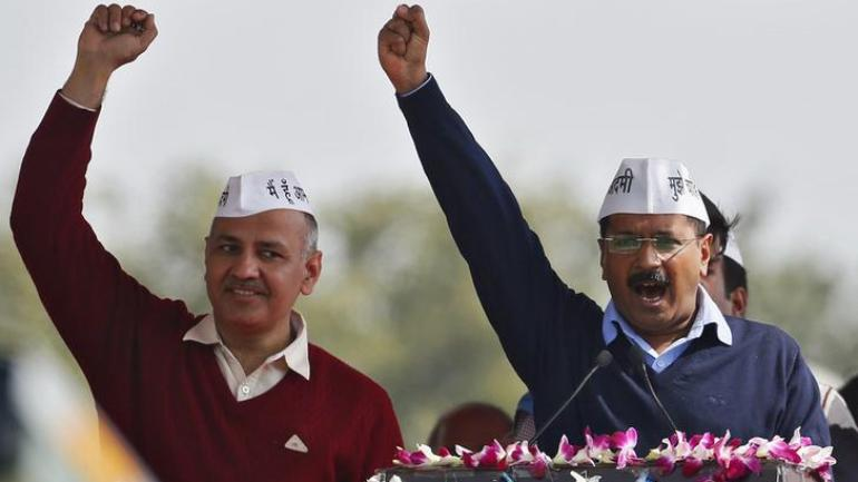 Delhi CM Arvind Kejriwal and Deputy CM Manish Sisodia at the swearing-in ceremony of the AAP government, at Ramlila Maidan in New Delhi in 2015. (Photo: Reuters)