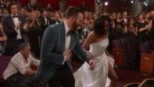 Chris Evans helping Regina King at the Oscars 2019