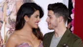 Nick Jonas saves Priyanka Chopra from falling at the Isn't it Romantic premiere. Watch video
