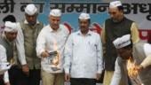 Aag laga denge: AAP and BJP burn each other's election manifestos